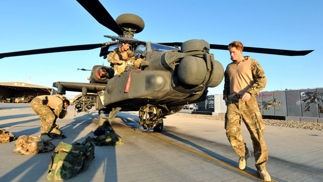 PHOTO: Prince Harry does a pre-flight check of his Apache Helicopter after starting his 12 hour VHR (very high ready-ness) shift at the British controlled flight-line in Camp Bastion southern Afghanistan, Nov. 1, 2012.