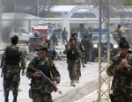 PHOTO: This image made from AP video shows Afghan National Army soldiers rushing to the scene moments after a car bomb exploded in front the PRT, Provincial Reconstruction Team, in Qalat, Zabul province, southern Afghanistan, Saturday, April 6, 2013.