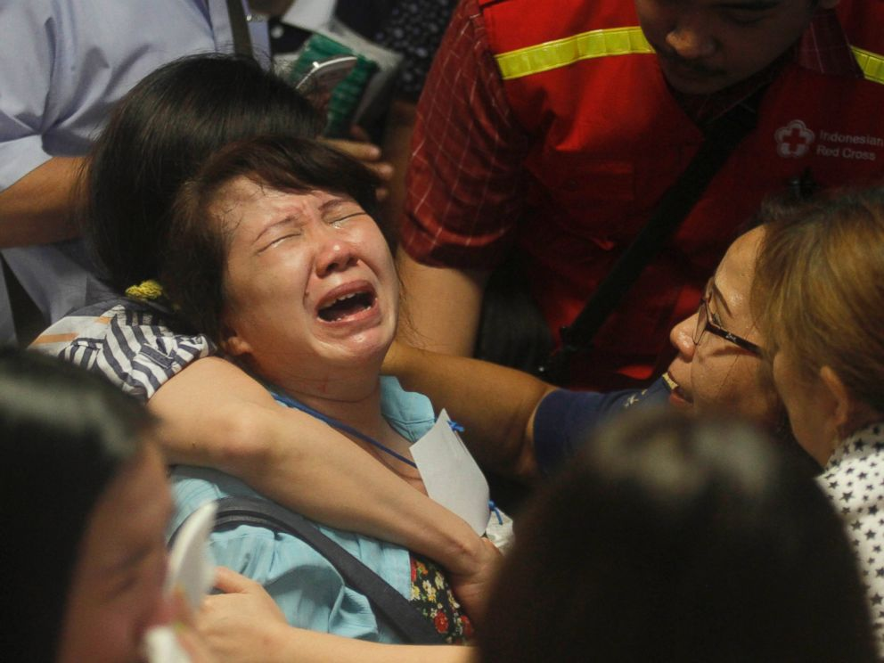 PHOTO: Relatives of passengers of the missing AirAsia flight QZ 8501 react to the news about the findings of bodies in the waters near the site where the jetliner disappeared, at Juanda International Airport in Surabaya, Indonesia, Dec. 30, 2014.