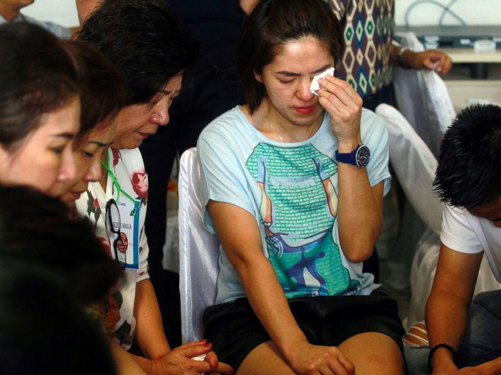 PHOTO: Relatives of passengers of the missing AirAsia flight QZ8501 wait at the crisis center at Juanda International Airport in Surabaya, Indonesia, Dec. 30, 2014.