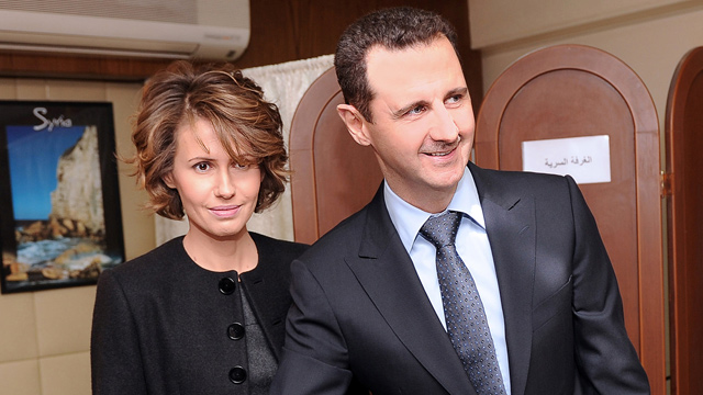 PHOTO: Syrian President Bashar Assad casts his ballot next to his wife Asma at a polling station, in Damascus, Syria, in this Feb. 26, 2012 file photo.