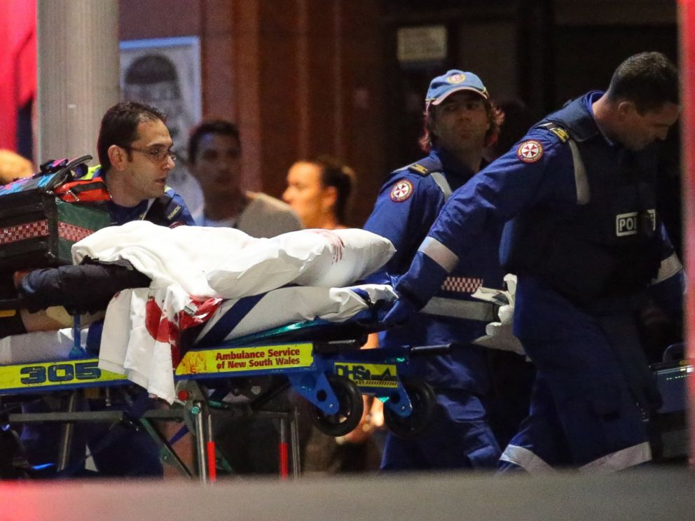 PHOTO: A stretcher is wheeled to an ambulance after shots were fired during a cafe siege at Martin Place in the central business district of Sydney, Australia, Dec. 16, 2014.