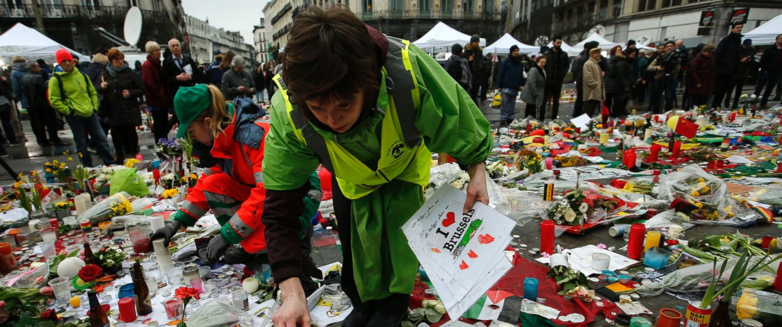 PHOTO: Workers from the City of Brussels collect some of the tributes to preserve them at the Place de la Bourse in Brussels, March, 25, 2016.