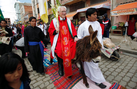 ap boliva palm sunday ss thg 120402 wblog Today in Pictures: Hindu Goddess festival, Damien Hirst, MyanMar Cheer, Bieber Slimed and The Pope