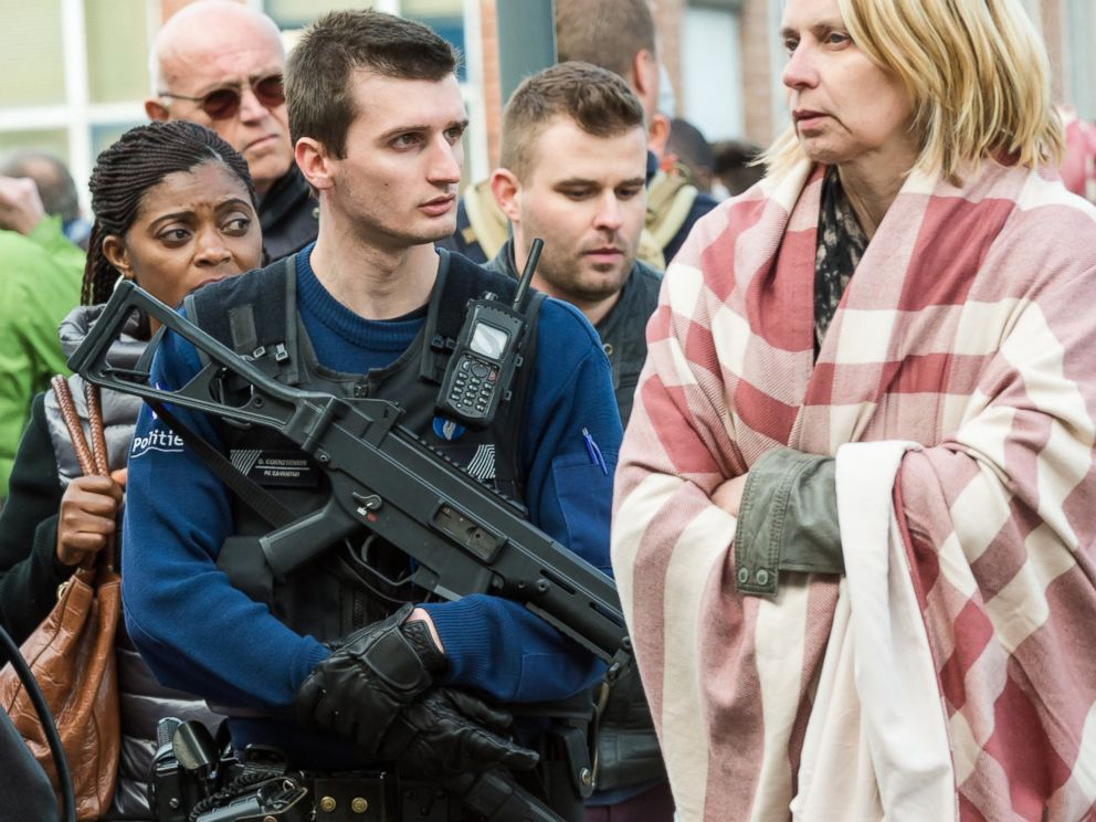 PHOTO: A police officer stands guard as people are evacuated from Brussels airport, after explosions rocked the facility in Brussels, Belgium, Tuesday March 22, 2016.