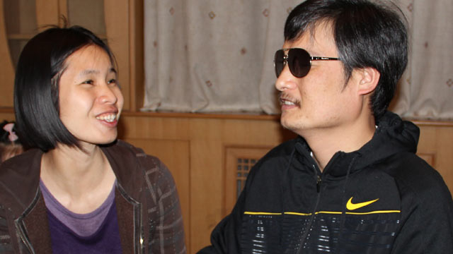 PHOTO: In this photo taken in late April, 2012, and released by Hu Jia, blind Chinese legal activist Chen Guangcheng, right, meets with Zeng Jinyan, the wife of human rights activist Hu Jia, at an undisclosed location in Beijing.