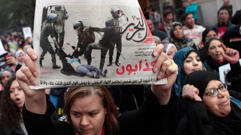 ap egypt woman dragged protest ss thg 111221 Wblog Today in Pictures: Dec. 21, 2011.