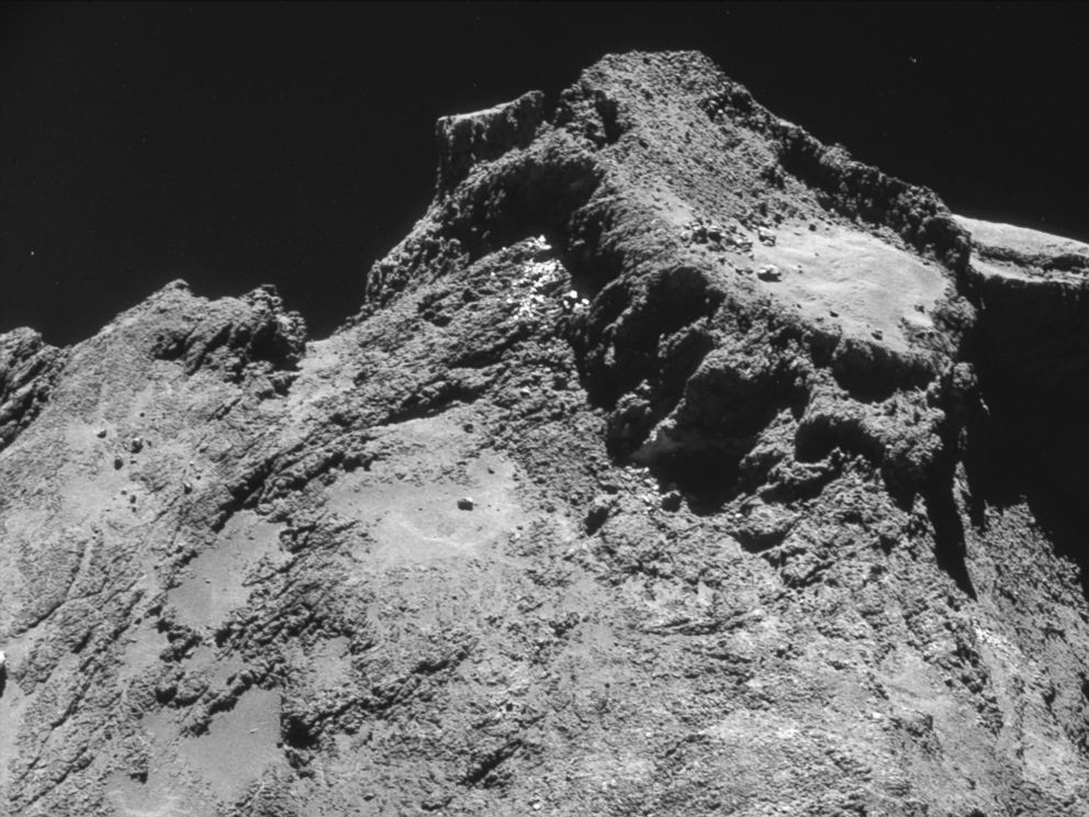 PHOTO: The picture taken with the navigation camera on Rosetta and released by the European Space Agency ESA shows a raised plateau on the larger lobe of Comet 67P/Churyumov?Gerasimenko.