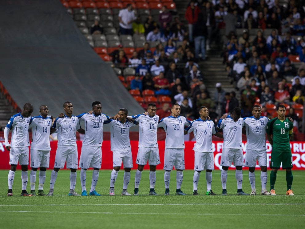 PHOTO: Honduras players stand during a moment of silence to honor the victims of the Paris terrorist attack before playing Canada in a 2018 World Cup qualifying soccer match in Vancouver on Nov. 13, 2015.