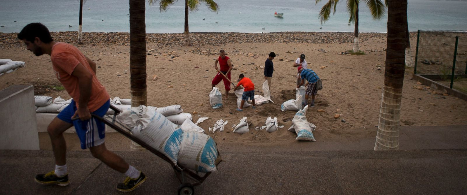 PHOTO: Residents prepare for the arrival of Hurricane Patricia filling sand bags to protect beachfront businesses, in Puerto Vallarta, Mexico, Oct. 23, 2015.