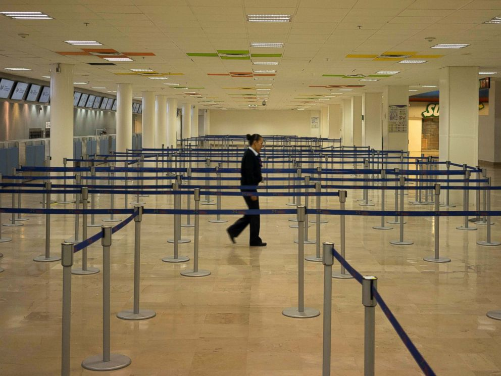 PHOTO: An airline employee walks through an empty airport where all flights are cancelled as Hurricane Patricia approaches the Pacific resort city Puerto Vallarta, Mexico, Oct. 23, 2015.
