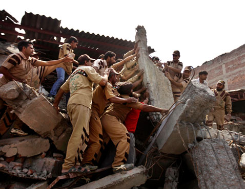 ap india building collapse nt 120416 wblog Pictures of the Day: North Korea Celebrates Birthday, Hillary Parties, and Kansas Tornado