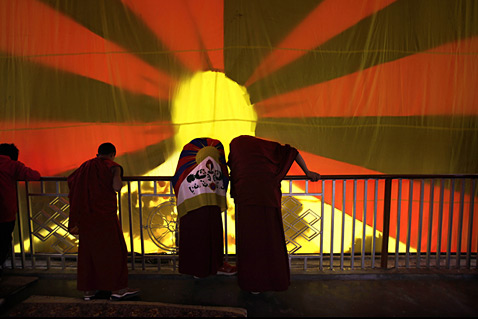 ap india tibet protest ll 120330 wblog Today in Pictures: Land Day, Beach Volleyball, Glowing Refinery