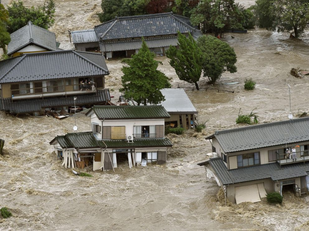 PHOTO: People inside houses wait to be rescued as the houses are submerged in water flooded from a river in Joso, Ibaraki prefecture, northeast of Tokyo, Sept. 10, 2015.
