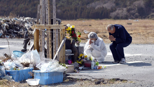 PHOTO: Residents pray in front of a memorial for the victims of the March 11, 2011 earthquake and tsunami as they make a brief visit to a caution zone in Namie, Fukushima prefecture, northern Japan Sunday, March 10, 2013.