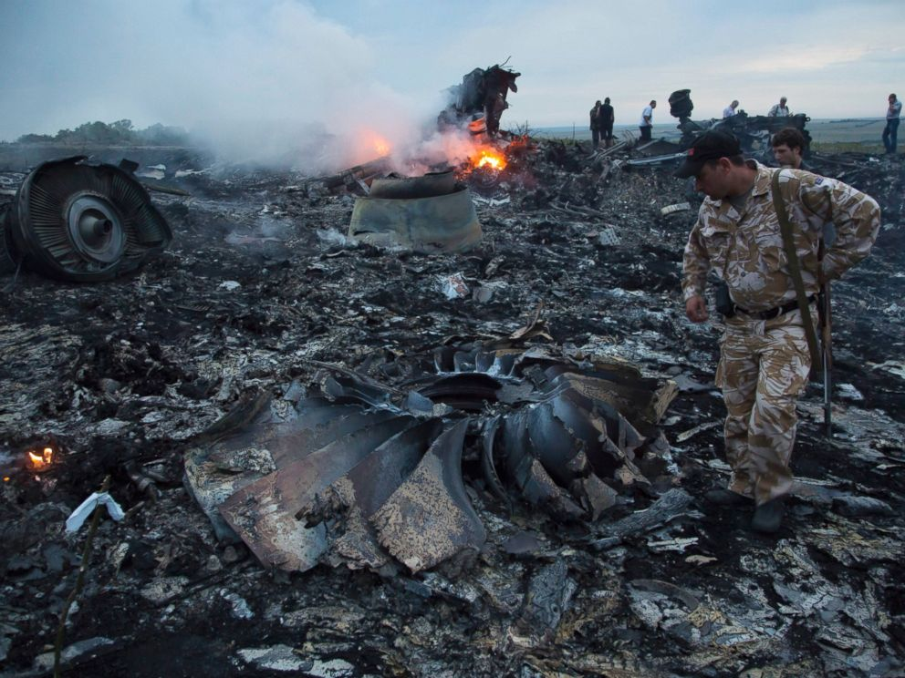 PHOTO: People walk amongst the debris at the crash site of Malaysia Airlines passenger plane near the village of Grabovo, Ukraine, July 17, 2014.