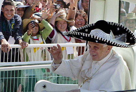 ap mexico pope sombrero ll 120326 wblog Today in Pictures: Monkey Allergies, Choked Up Actors, A Kiss from Uggie