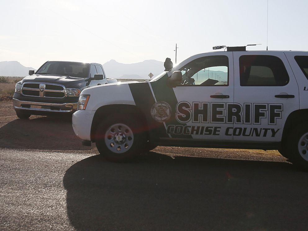 PHOTO: Cochise County Sheriff blocks the road on June 25, 2015, miles away from the site where an F-16 Fighting Falcon crashed near Douglas, Ariz.