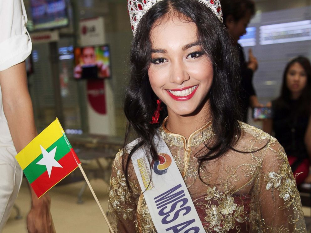 PHOTO: In this June 5, 2014 file photo, Myanmar model May Myat Noe, winner of Miss Asia Pacific World 2014 pageant, waves a miniature flag of the country upon her arrival at Yangon International Airport in Yangon, Myanmar.