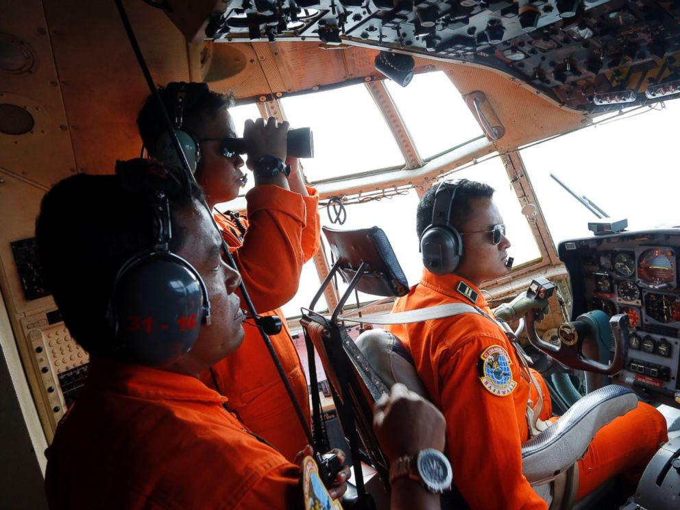 PHOTO: Crew of Indonesian Air Force C-130 airplane scan the horizon while searching for the missing AirAsia flight 8501 jetliner over the waters of Karimata Strait in Indonesia, Dec. 29, 2014.