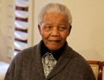 PHOTO: Former South African President Nelson Mandela celebrates his birthday with family in Qunu, South Africa, July 18, 2012. The South African presidency says Nelson Mandela was re-admitted to hospital with a recurrence of a lung infection, March 28, 20
