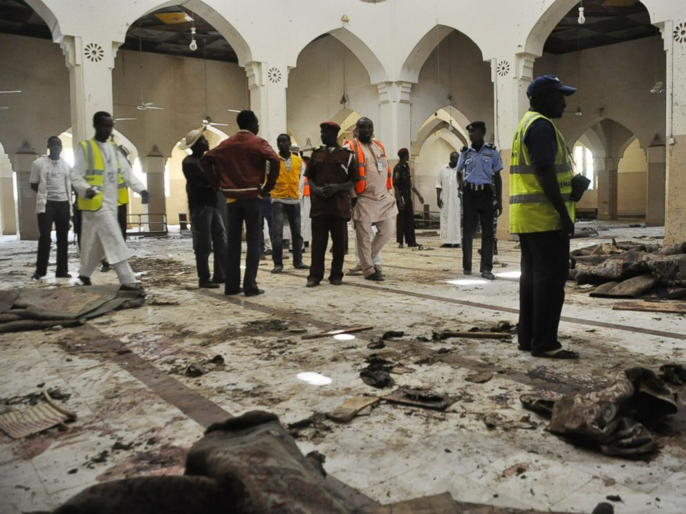 PHOTO: People inspect the central mosque following a bomb explosion in Kano, Nigeria, Nov. 29, 2014. No group claimed responsibility for the attack but as it bears the hallmarks of past attacks by Boko Haram, many assume that group to be responsible.