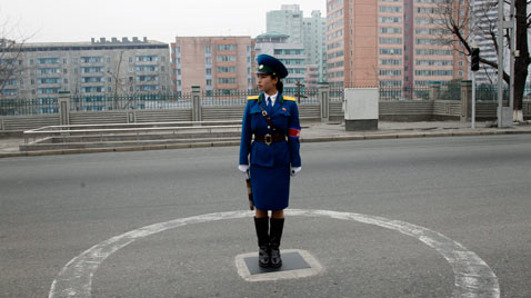 ap north korea traffic guard thg 120410 wblog Today in Pictures, Syrian Protests, Sikh Pilgrims, Gymnastics, Trapped Miners and Puppies