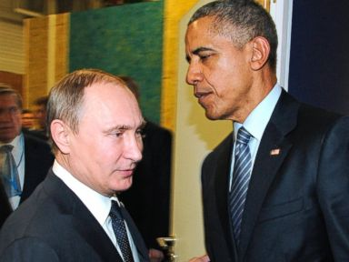 PHOTO: Russian President Vladimir Putin and U.S. President Barack Obama shake hands at the COP21 UN Conference on Climate Change in Paris, Nov. 30, 2015.