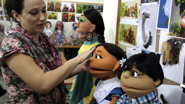 PHOTO: An artist gives final touches to characters of Pakistani Sesame Street in Lahore, Pakistan, Oct. 13, 2011.