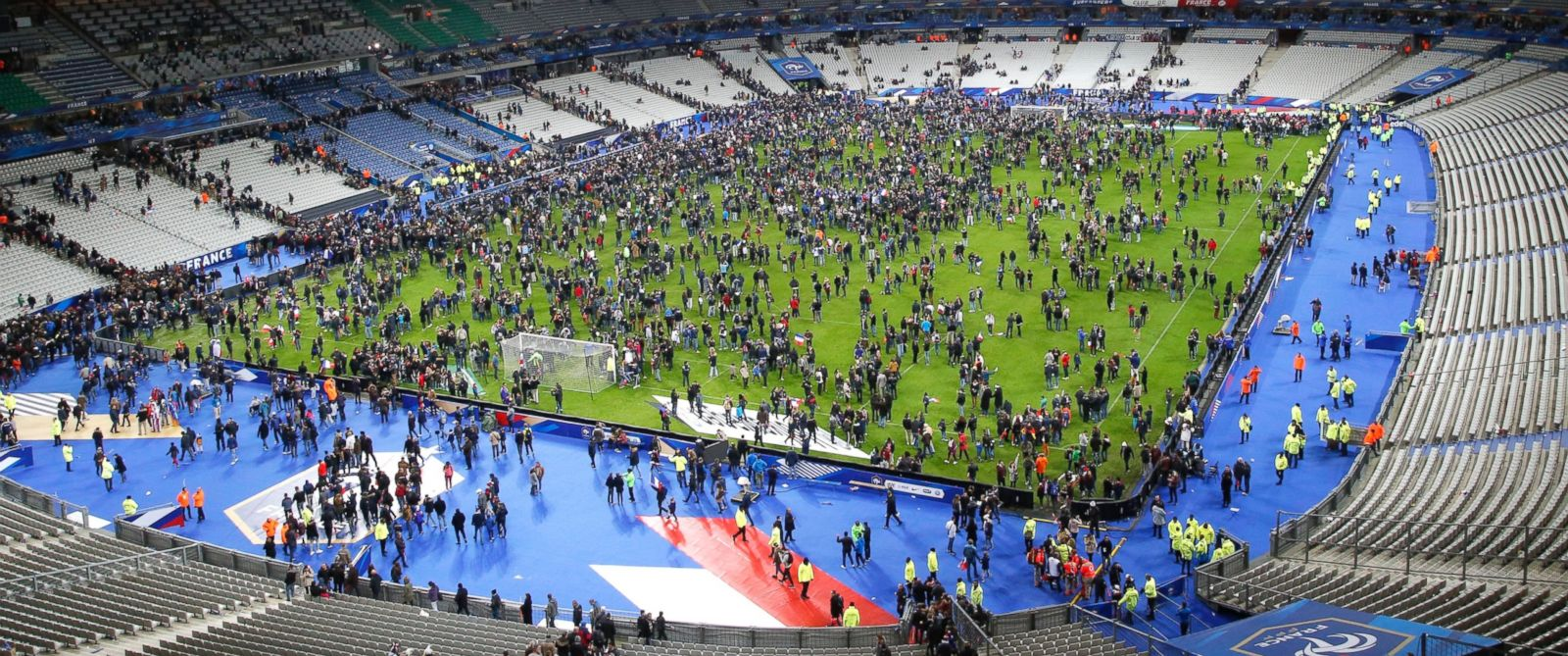 PHOTO: Spectators invade the pitch of the Stade de France stadium after the international friendly soccer France against Germany, Nov. 13, 2015 in Saint Denis, outside Paris.