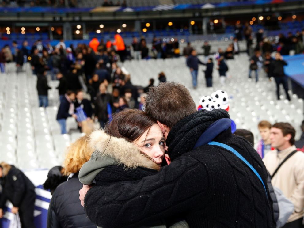PHOTO: A supporter comforts a friend after invading the pitch of the Stade de France stadium at the end of the international friendly soccer match between France and Germany in Saint Denis, outside Paris, Nov. 13, 2015.