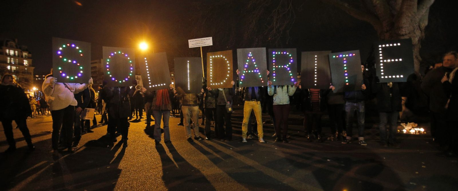 """PHOTO: People hold up a sign reading """"Solidarity"""" during a rally in Paris, France, Sunday, Jan. 11, 2015."""