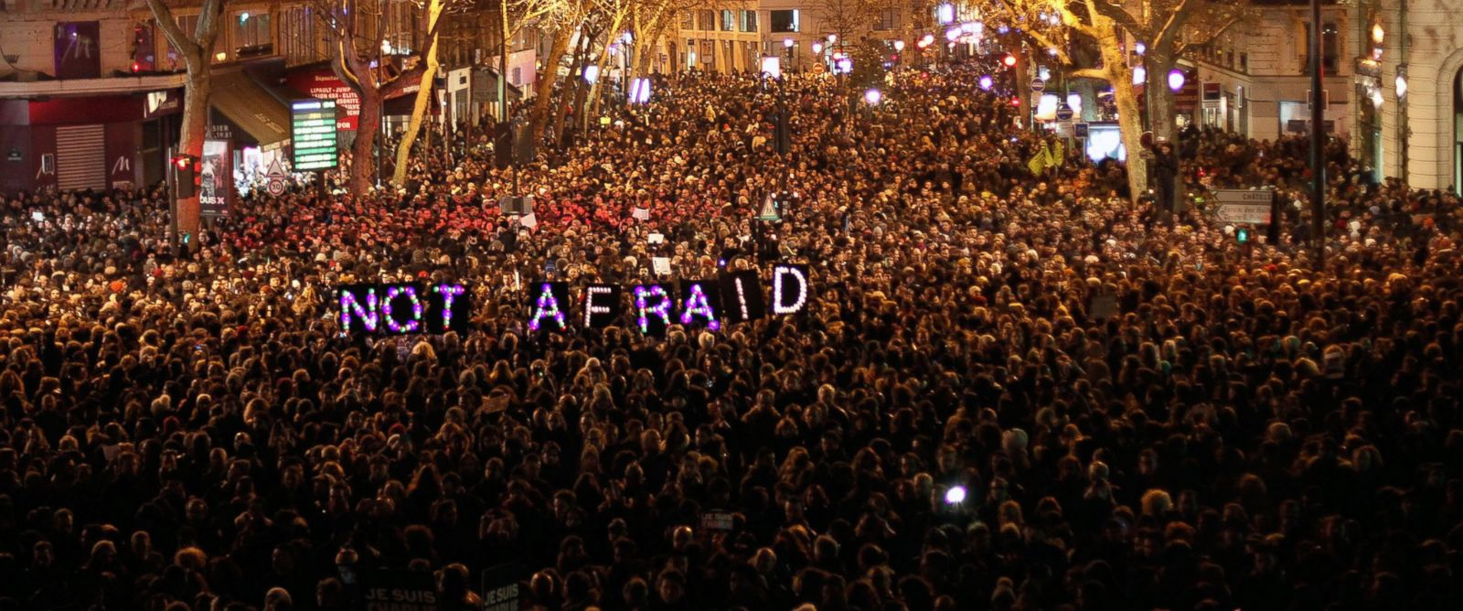 PHOTO: People gather to pay respect for the victims of a terror attack against a satirical newspaper, in Paris, in Paris, Jan. 7, 2015.