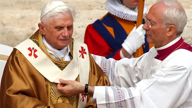 PHOTO: In this April 24, 2005 file photo, Archbishop Piero Marini drapes Pope Benedict XVI with the pallium during his installment Mass in St. Peter's Square at the Vatican.