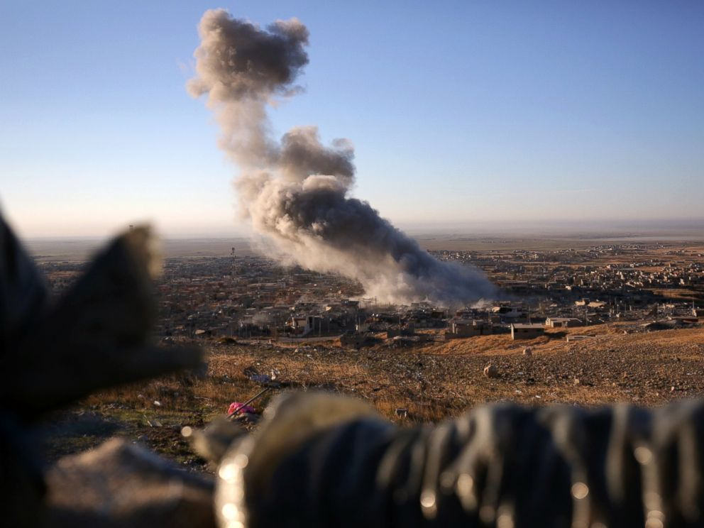 PHOTO: Smoke believed to be from an airstrike billows over the northern Iraqi town of Sinjar on Nov. 12, 2015.