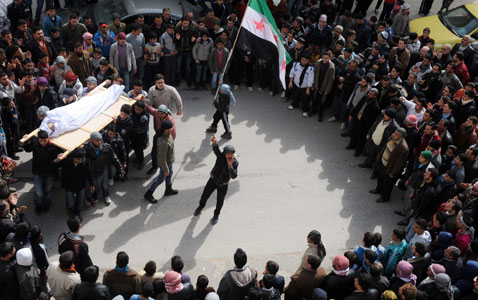 ap syria funeral nt 120223 wblog Today in Pictures: Syria Mourners, Republican Debate, and Avalanches in Kashmir