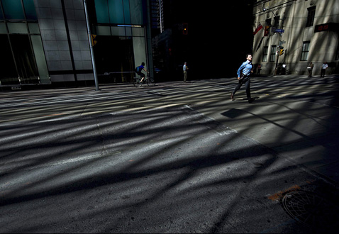 ap toronto financial district ll 120614 wblog Today in Pictures: Toronto Shadows, Egypt Protests, Motorcycle Jump