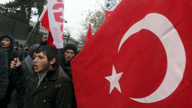 PHOTO: Leftist Turkish students stage a protest outside the French Embassy in Ankara, Turkey on Dec. 24, 2011.
