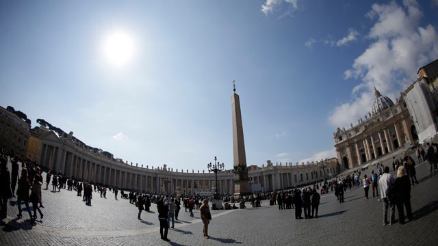 PHOTO: People walk in St. Peters Square at the Vatican, March 3, 2013.