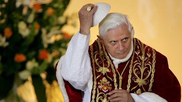 PHOTO: Pope Benedict XVI lifts his scull cap during an ecumenical meeting at the Holy Trinity church in Warsaw, Poland, May 25, 2006.