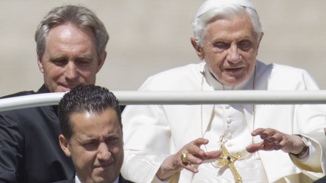 PHOTO: In this photo taken Wednesday, May, 23, 2012, Pope Benedict XVI, flanked by his private secretary Georg Gaenswein, top left, and his butler Paolo Gabiele arrives at St.Peters square at the Vatican for a general audience.