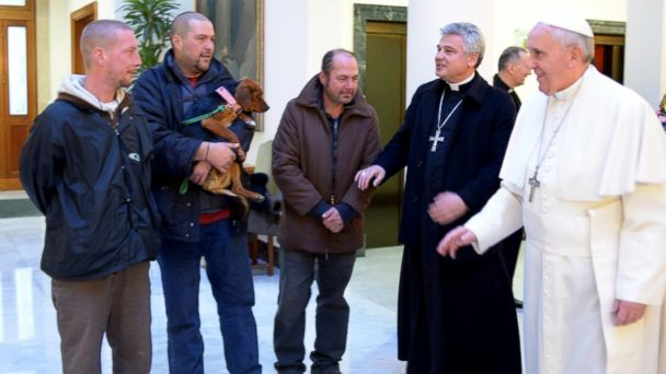 PHOTO: Pope Francis, right, welcomes homeless men, Dec. 17, 2013, who helped the Pope celebrate his 77th birthday at the Vatican.