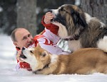 PHOTO: Vladimir Putin playing with his dogs