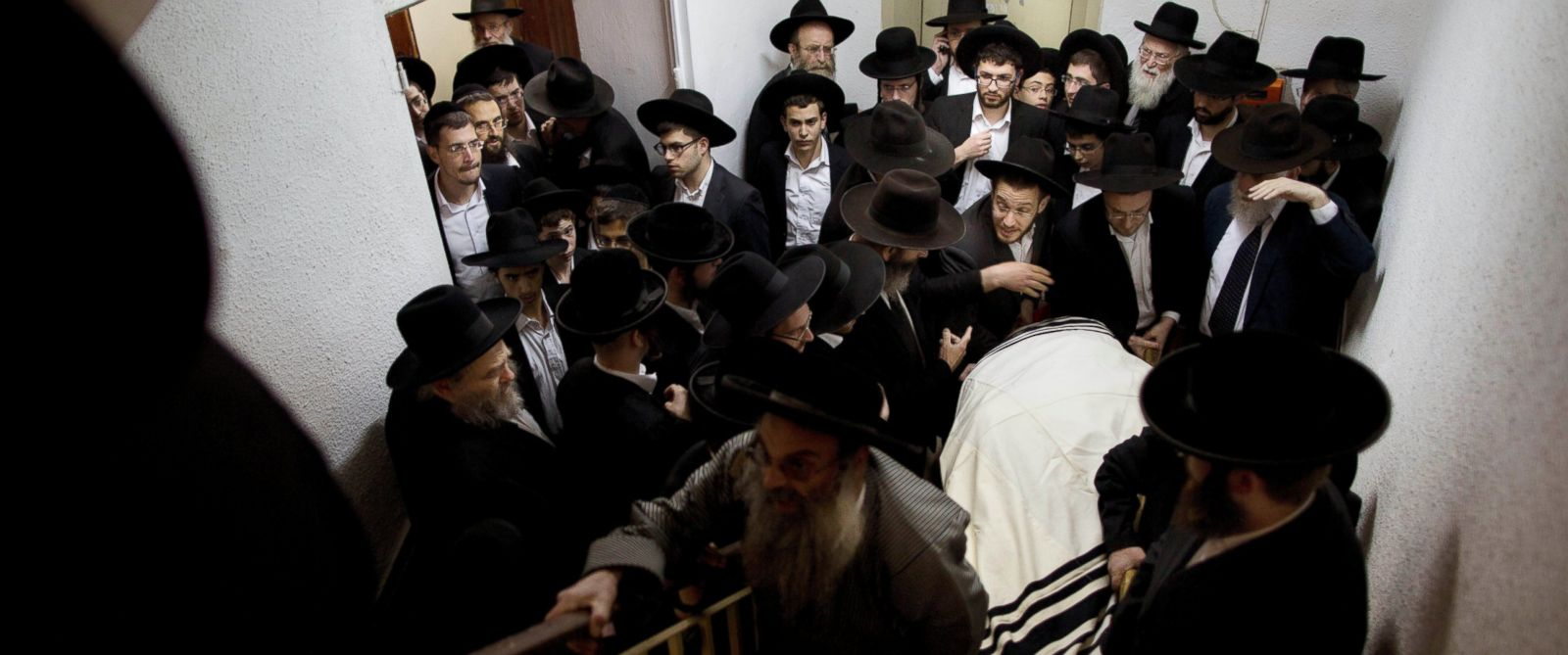 PHOTO: Ultra-Orthodox Jews carry the body of Mosheh Twersky during his funeral in Jerusalem, Nov. 18, 2014.