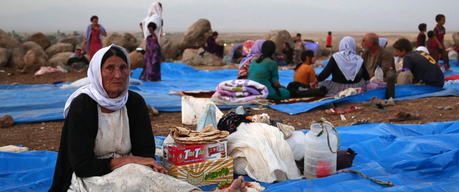 PHOTO: Displaced Iraqis from the Yazidi community settle at a camp at Derike, Syria, Sunday, Aug. 10, 2014.