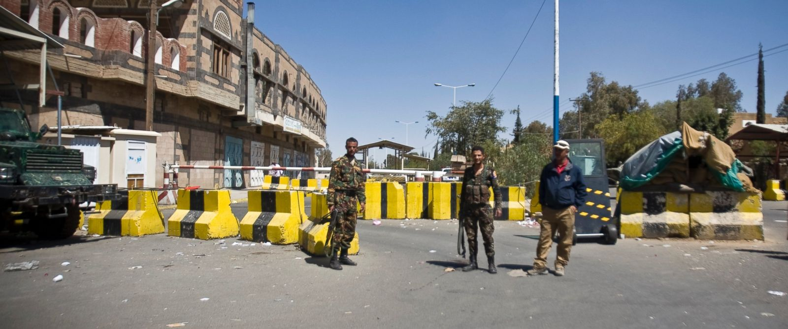 PHOTO: Police troopers stand guard at the entrance of the U.S. Embassy in Sanaa, Yemen, Feb. 11, 2015.