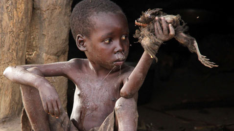 corbis uganda nodding boy diseas ss thg 120313 wblog Today in Pictures: Cheltenham Horse Race, Gaza Mourns, Afghanistan Protests, and Turtles