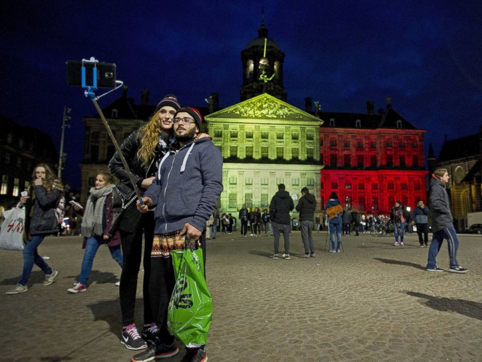 PHOTO: The Royal Palace at Dam Square in Amsterdam is projected with the colors of the Belgian flag in tribute to the victims of the Brussels terror attacks that occured earlier in the day, Amsterdam, the Netherlands, March 22, 2016.