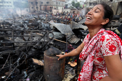 epa burnt shanty town wb nt 120516 Today in Pictures: Shanty Town Fire, Elk Sighting, and Cannes