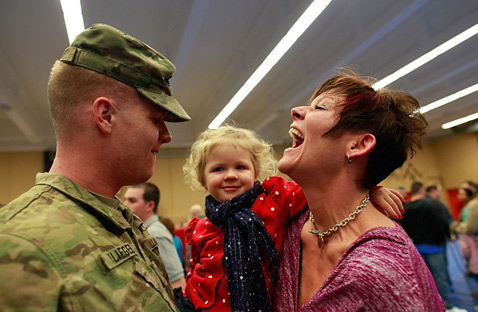 gty 137857664 Today in Pictures: Soldiers Homecoming, Romney on Campaign Trail, Little Gandhis